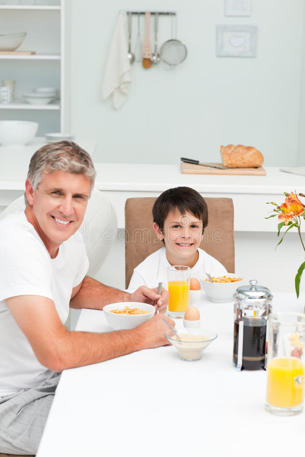 Download Father Having His Breakfast With His Son Stock Image - Image: 17937719