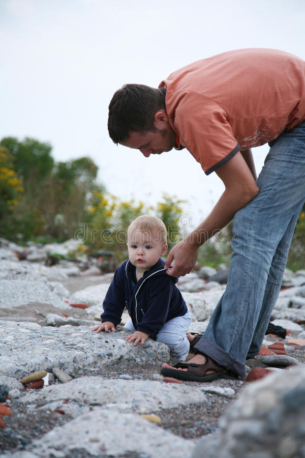Download Father Helping Baby Royalty Free Stock Image - Image: 29034806