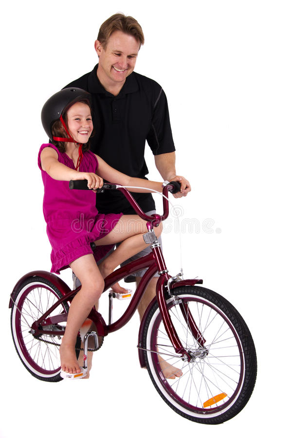 Father helping his daughter stock photography