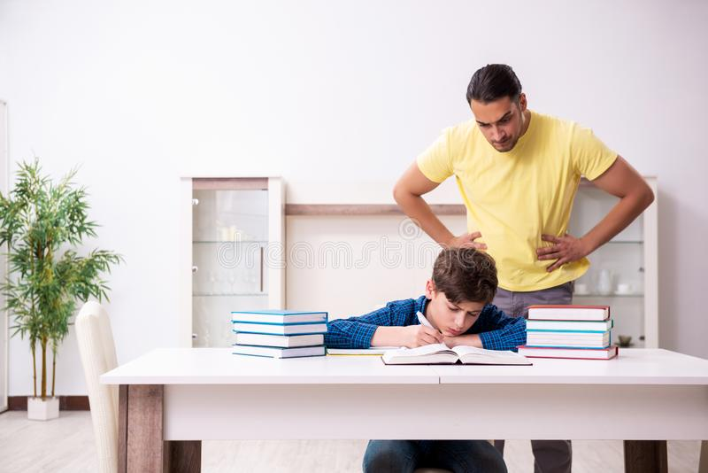 Father helping his son to prepare for school stock photography