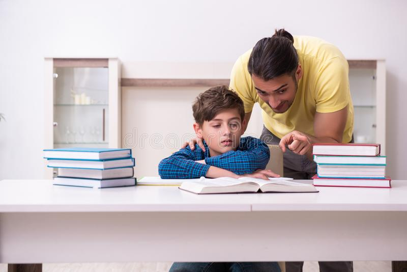 Father helping his son to prepare for school stock photo