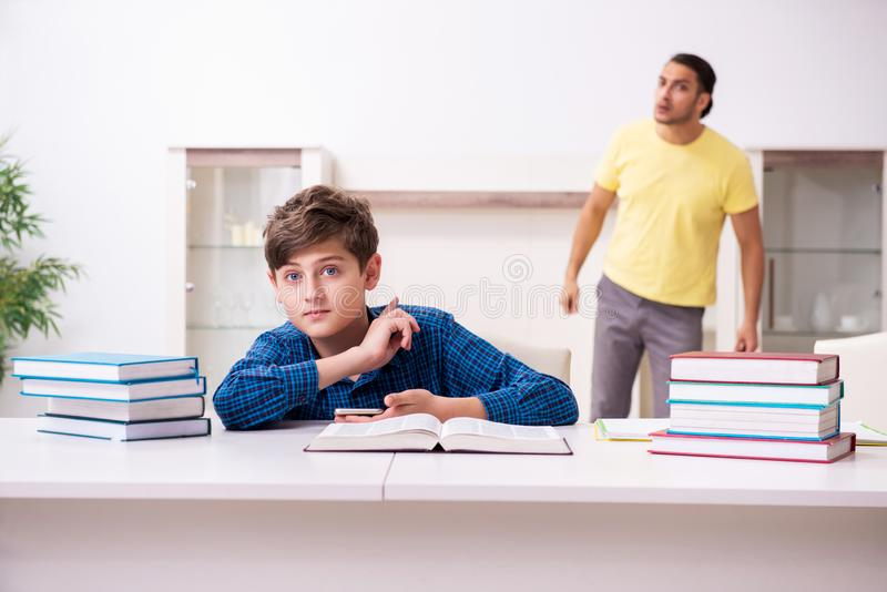 Father helping his son to prepare for school royalty free stock photo