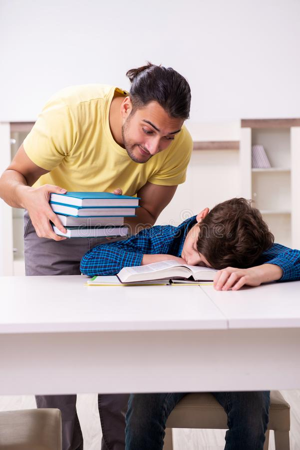 Father helping his son to prepare for school royalty free stock image