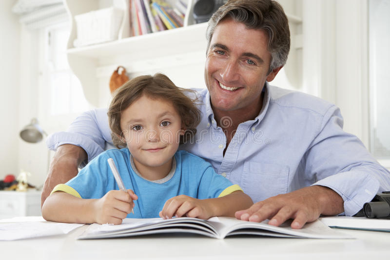 Father Helping Son With Homework royalty free stock photo