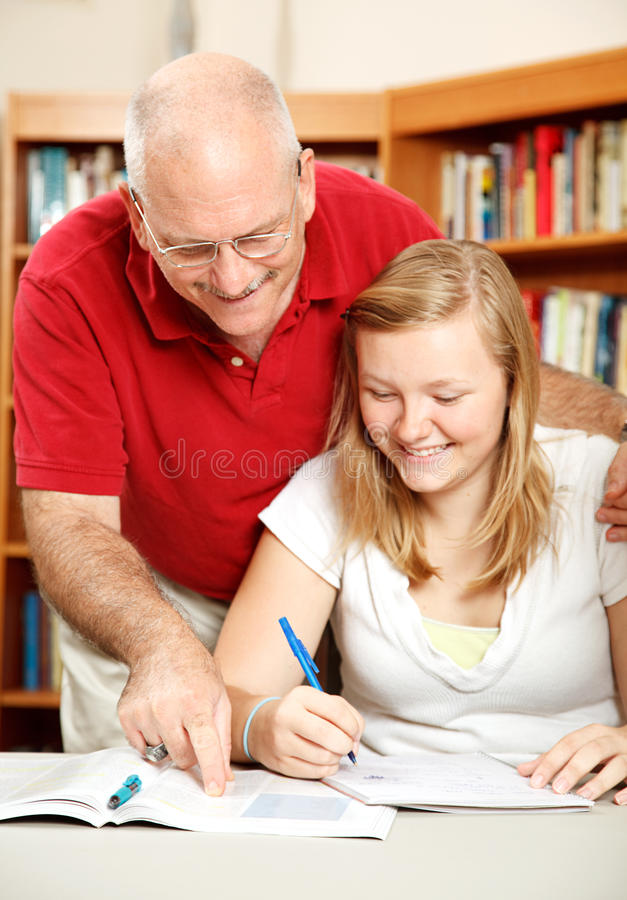 Download Father Helps Daughter Study Stock Photo - Image: 19470418