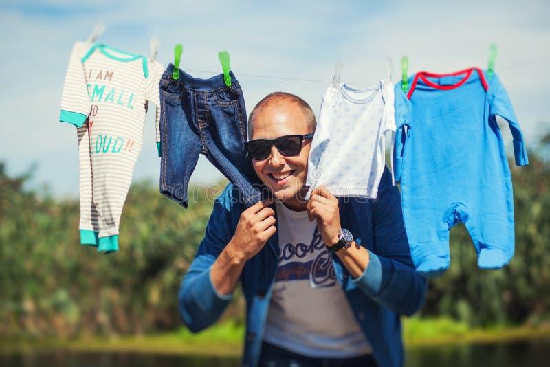 Father hiding between son's clothes royalty free stock photos