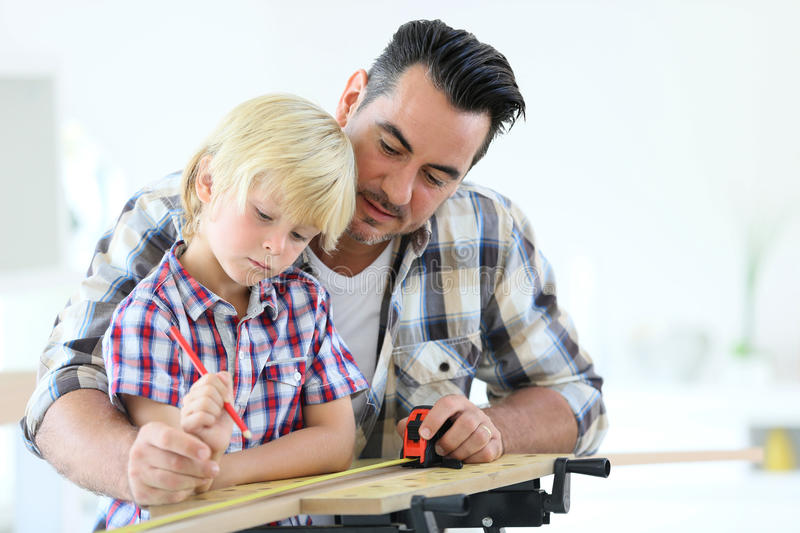 Father with his boy working on renovation stock photography