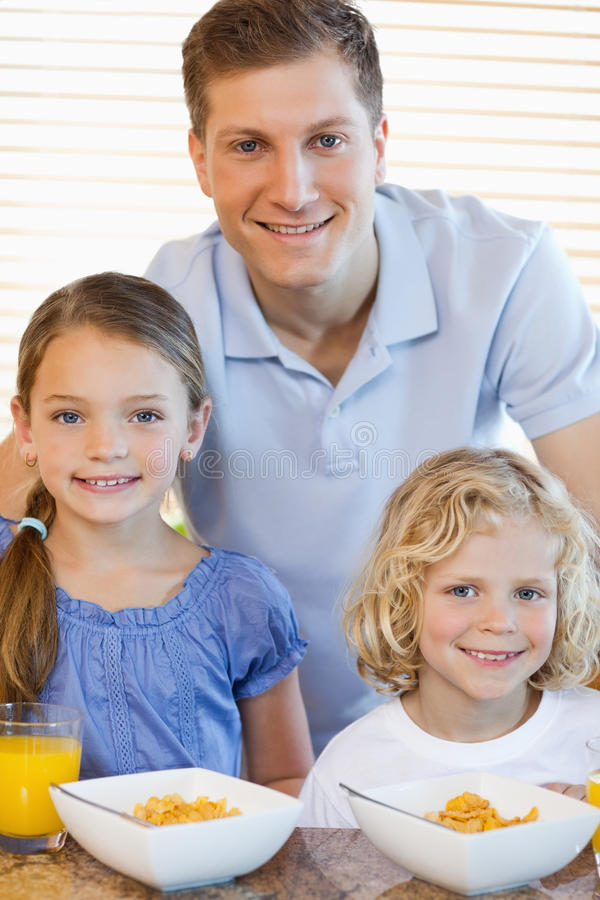 Download Father With His Children And Cereals Stock Photo - Image: 22438992