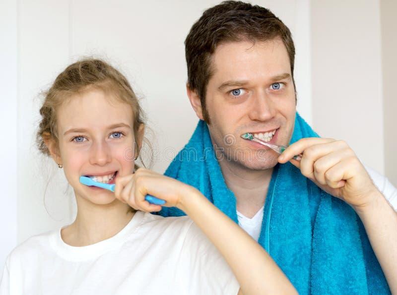 Family brushing teeth. royalty free stock photo