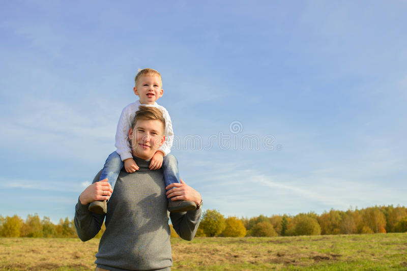 Father and his little son walking outdoors stock photo