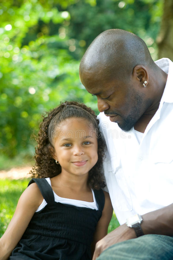 A father and his mixed race daughter stock photography