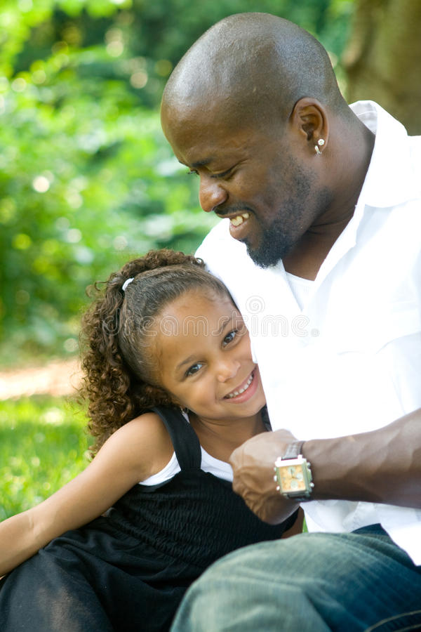 A father and his mixed race daughter royalty free stock photos