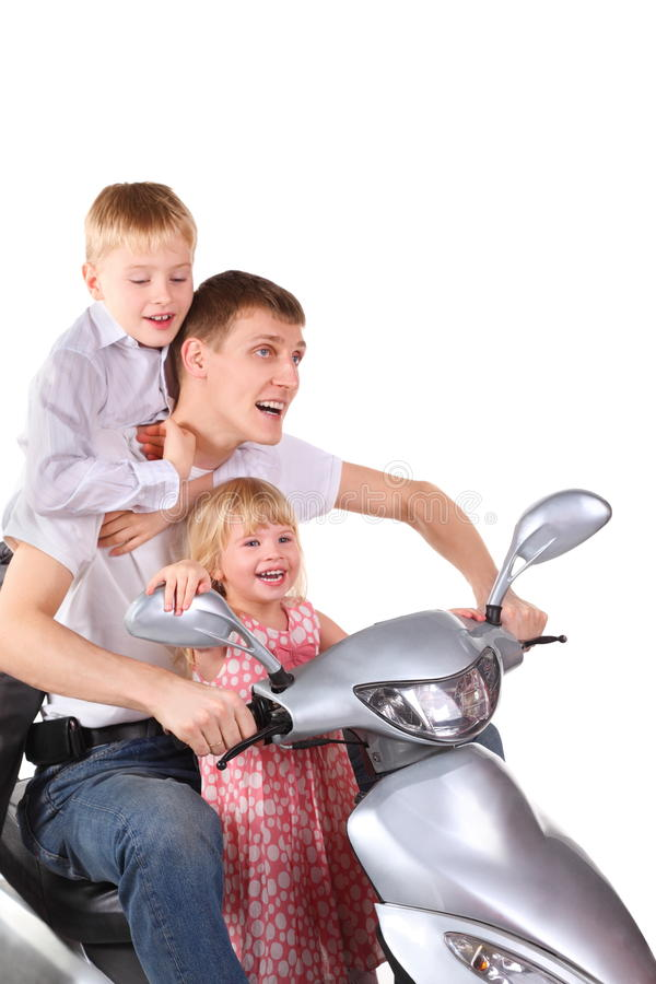 Father and his son and daughter on motorcycle