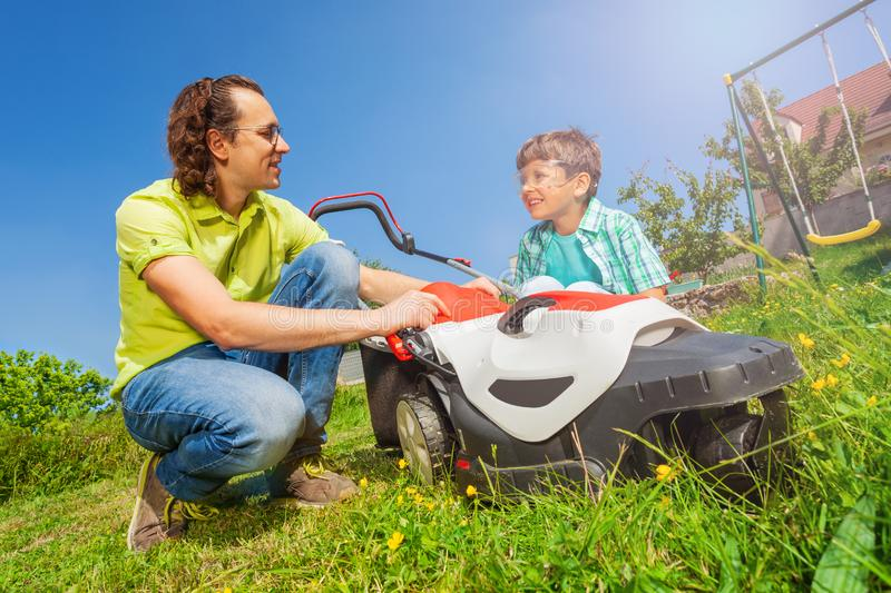 Father with his son working together at the garden stock photography