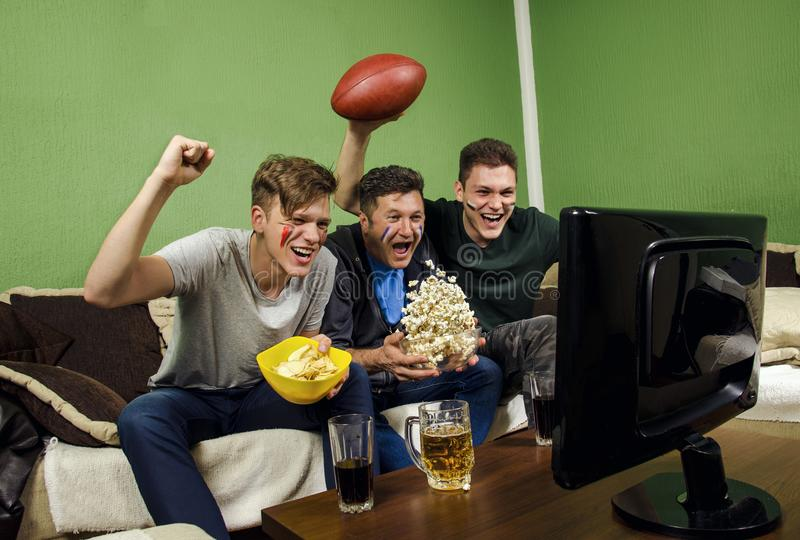 Father and his sons celebrating touchdown stock images