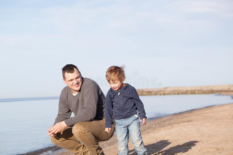 Father with his young son at the beach royalty free stock images