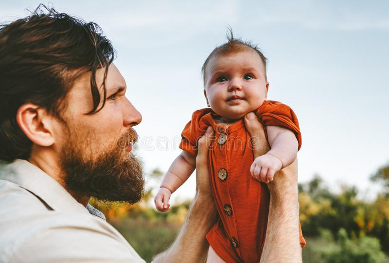 Father holding infant baby outdoor family lifestyle stock image