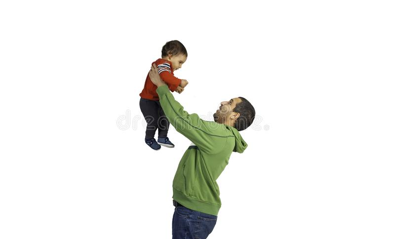 Father holding and lifting up his cute baby royalty free stock photography
