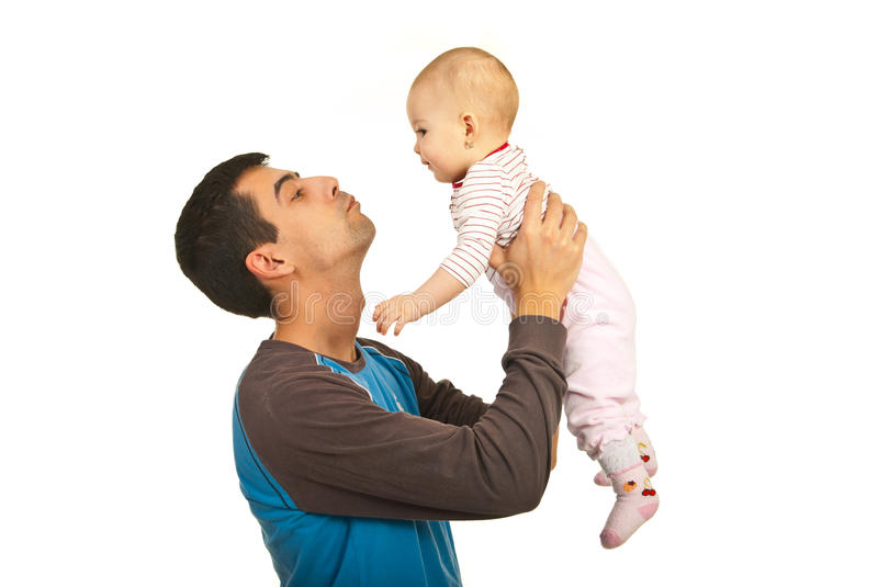 Father holding up his baby girl royalty free stock photography