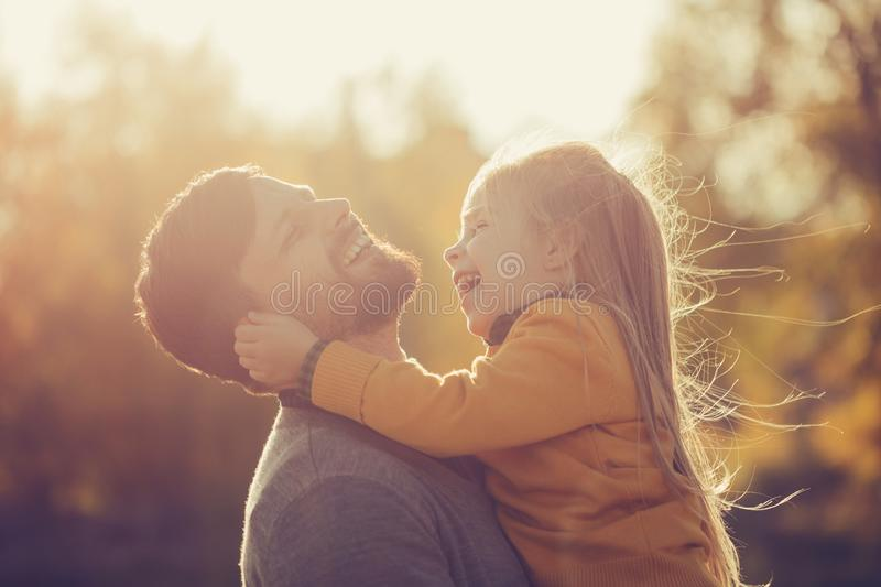 Father holds daughter in his arms royalty free stock images