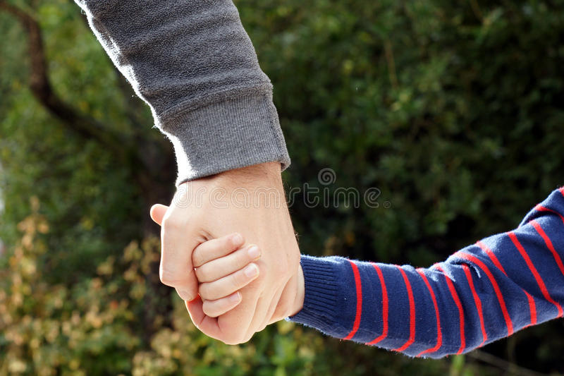 Download Father Holds Daughter's Hand Stock Photo - Image: 29120734