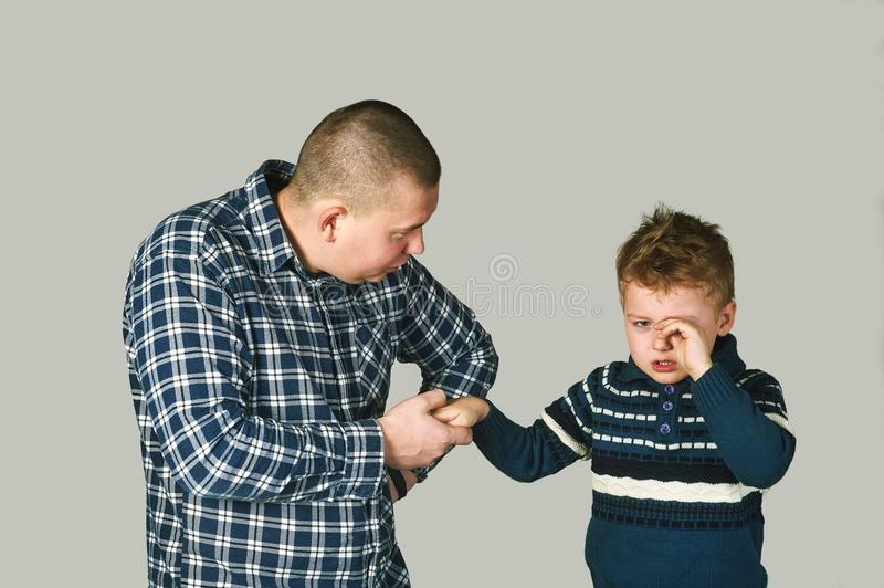 Father and upset, crying boy royalty free stock images