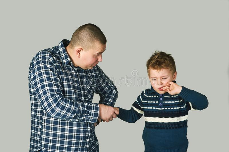 Father and upset, crying boy stock photography