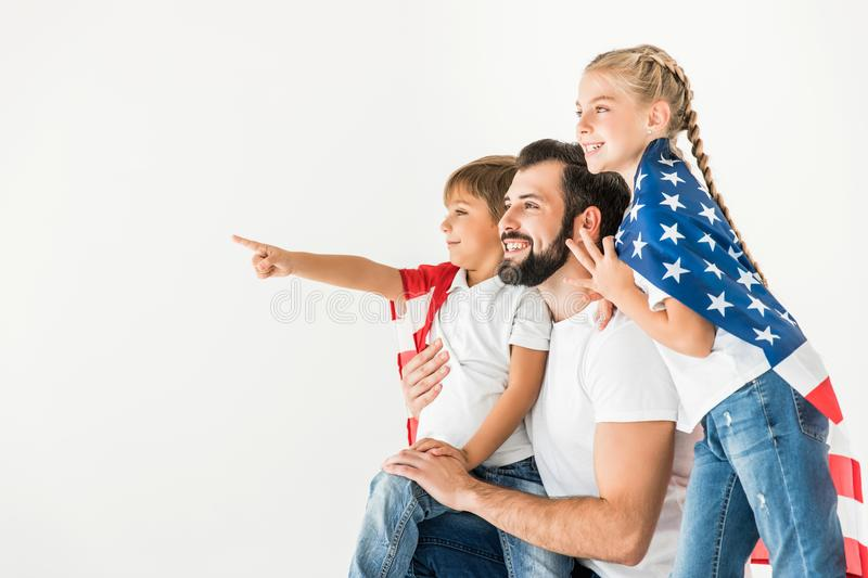 Father and kids with american flag stock image