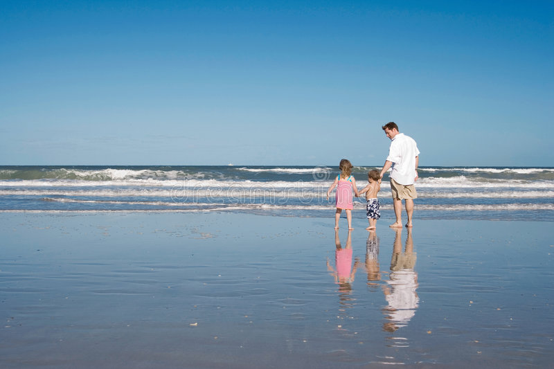 Download Father and kids on a beach stock image. Image of ocean - 2317935