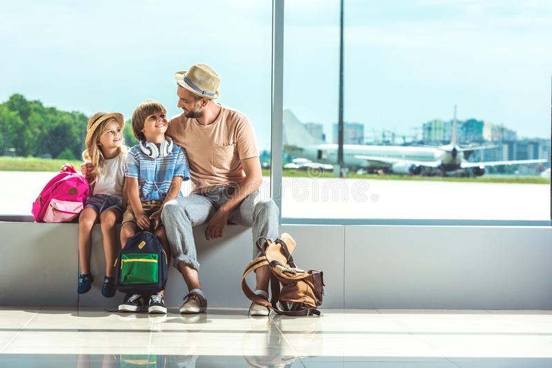 Father and kids waiting for boarding royalty free stock photos