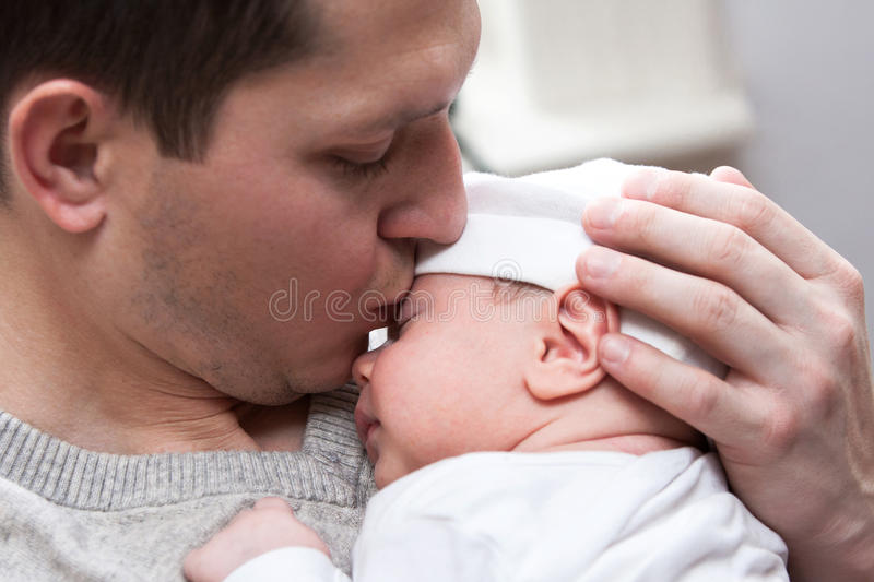 Father kissing baby royalty free stock photo