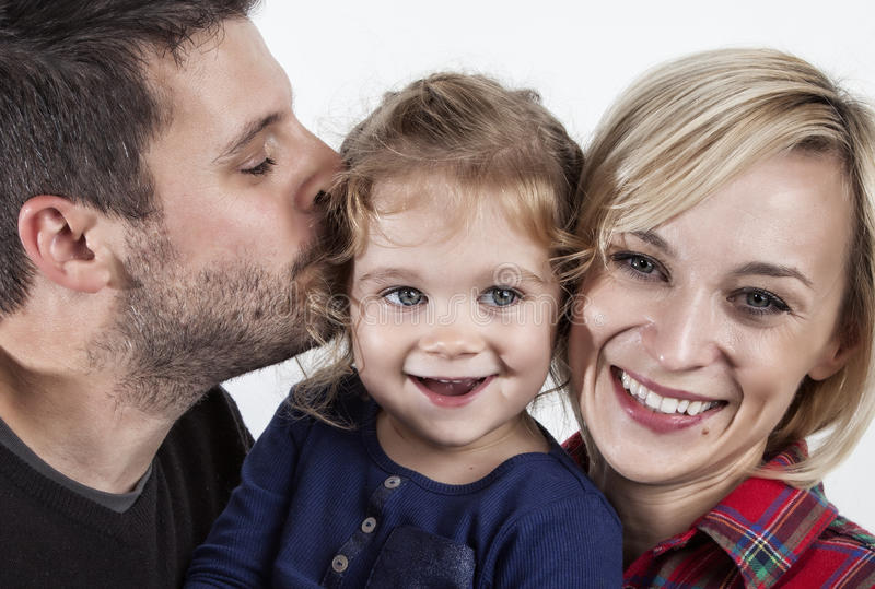 Father kissing his little daughter stock photography