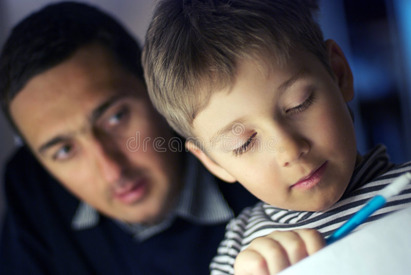 The father learns the son stock image