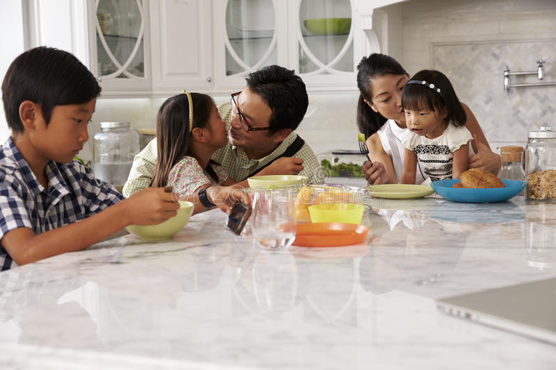 Father Leaving For Work After Family Breakfast In Kitchen stock photo