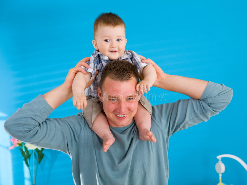 Download Father lifting happy baby stock photo. Image of happiness - 7156322