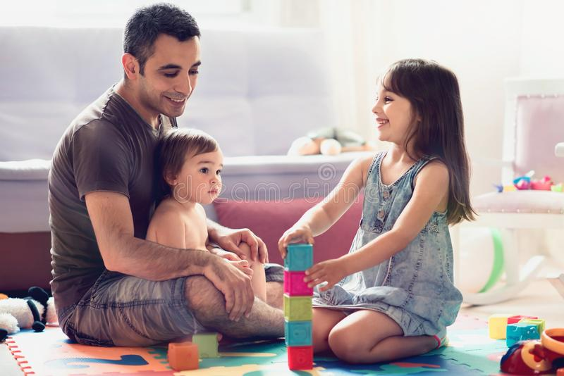 Father And Little Child Daughters Playing With Toys royalty free stock image