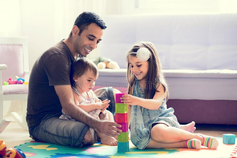Father And Little Child Daughters Playing With Toys. At Home royalty free stock photos