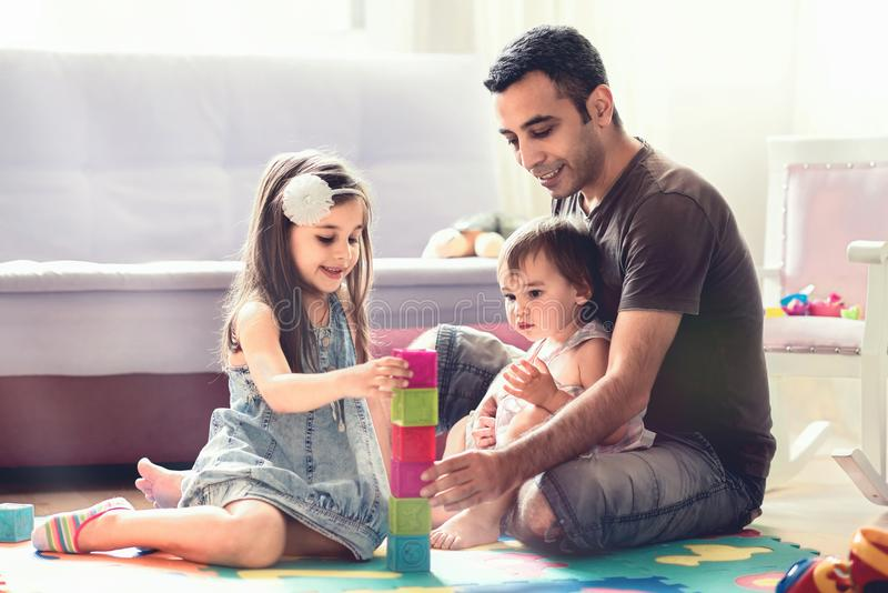 Father And Little Child Daughters Playing With Toys. At Home stock photos
