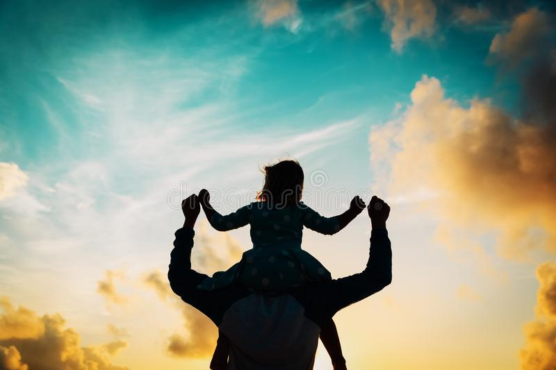 Download Father And Little Daughter On Shoulders Play At Sunset Stock Photo - Image of parent, cheerful: 114288822