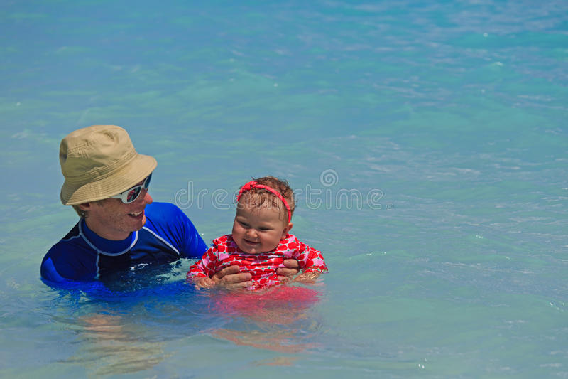 Father and little daughter swimming. At the sea stock photos