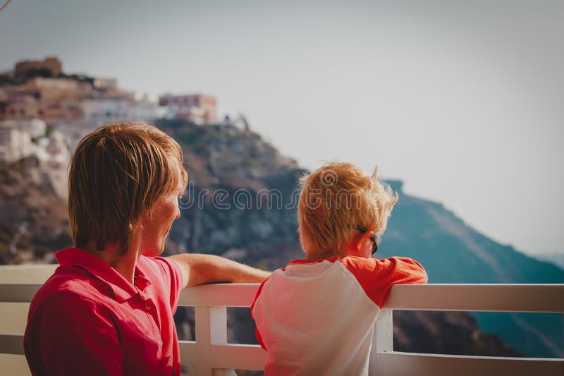 Father and little son looking at caldera in Santorini, Greece royalty free stock images