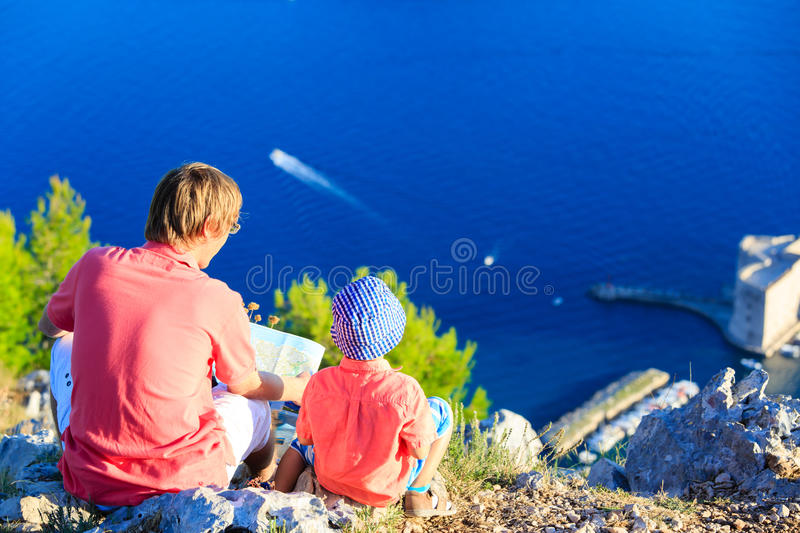 Father and little son looking at scenic view in Croatia royalty free stock photography