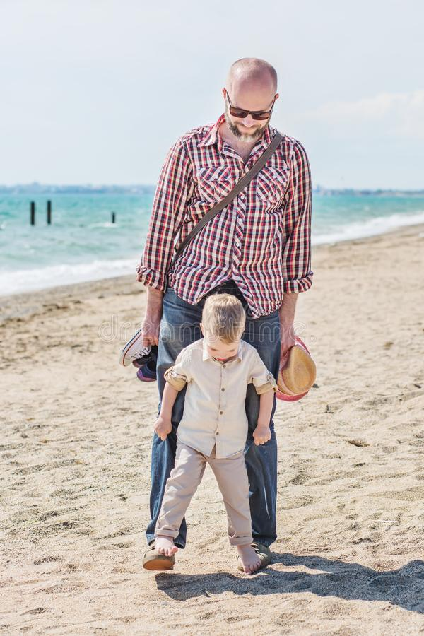 Father and little son playing royalty free stock photos