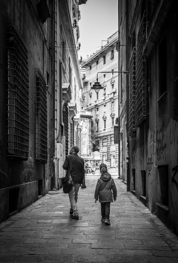 Father with little son walking by the narrow old Italian streets stock photo