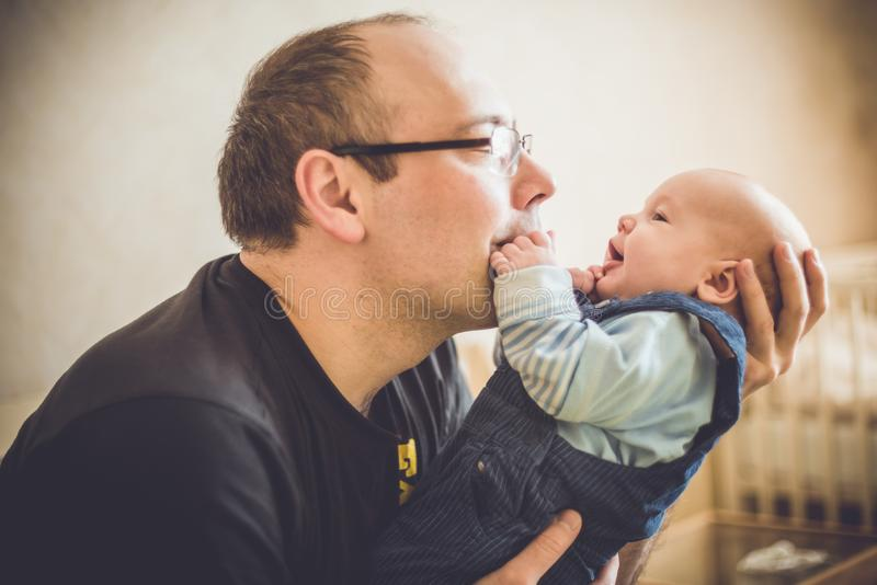 Father loves his baby. Holding on his arms stock image