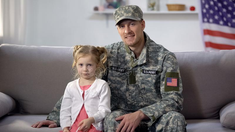 Father military posing to camera with little daughter, long awaited meeting. Stock photo royalty free stock photos