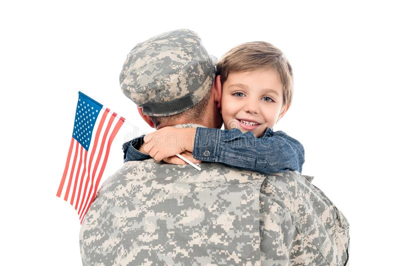 father in military uniform embracing with son stock image
