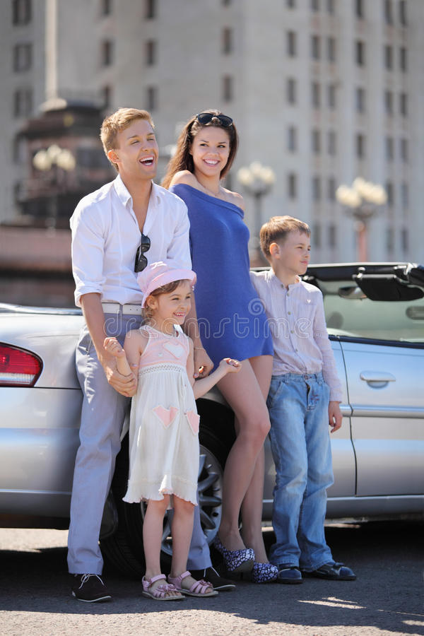 Download Father, Mother And Children Stand Near Car Stock Photo - Image: 25150680