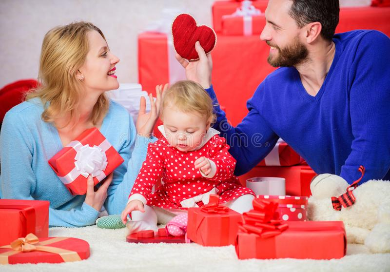 Father, mother and doughter child. He will never let her go. Happy family with present box. Valentines day. Red boxes. Love and trust in family. Bearded man stock photo