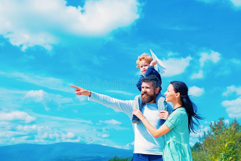 Father mother and son in the park. Freedom to Dream - Joyful Boy Playing With Paper Airplane. royalty free stock image